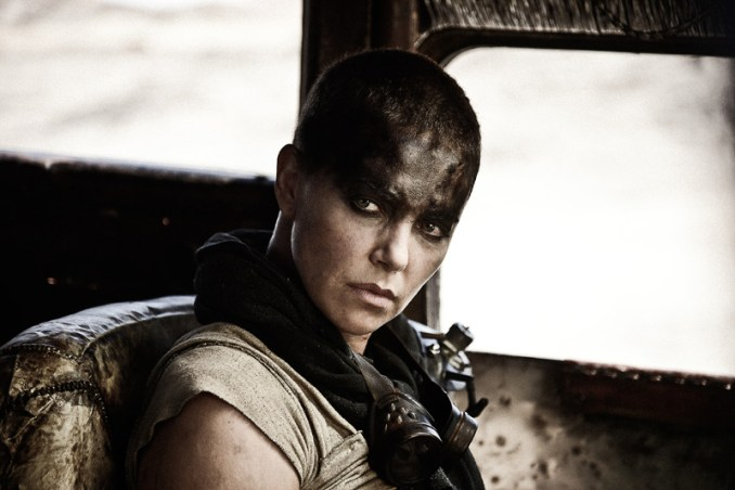 "CHARLIZE THERON as Furiosa in Warner Bros. Pictures' and Village Roadshow Pictures' action adventure ""MAD MAX: FURY ROAD,"" a Warner Bros. Pictures release. Photo by Jasin Boland"