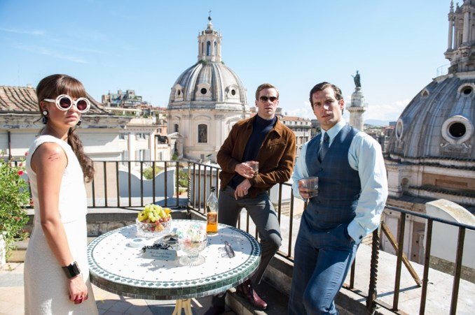 """(L-r) ARMIE HAMMER as Illya Kuryakin, ALICIA VIKANDER as Gaby Teller and HENRY CAVILL as Napoleon Solo in Warner Bros. Pictures' action adventure """"THE MAN FROM U.N.C.L.E.,"""" a Warner Bros. Pictures release. Photo by Daniel Smith"""