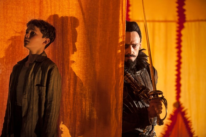 "(L-r) LEVI MILLER as Peter and HUGH JACKMAN as Blackbeard in Warner Bros. Pictures' action adventure ""PAN,"" a Warner Bros. Pictures release. Photo by Laurie Sparham"
