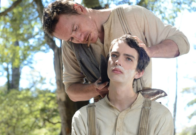 Silas Selleck (Michael Fassbender) and Jay Cavendish (Kodi Smit-McPhee) in SLOW WEST, an A24 release. Photography by Robbie Ryan