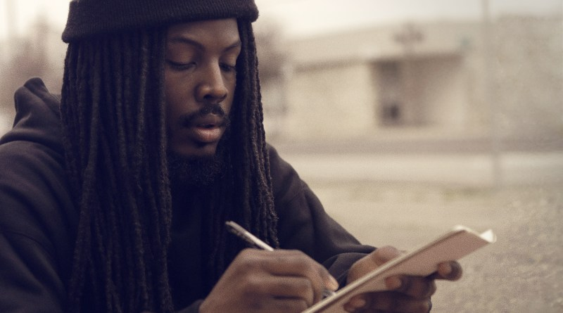 A till of Donte Clarke writing in the 2014 documentary, Romeo is Bleeding. Image courtesy of Romeo is Bleeding.