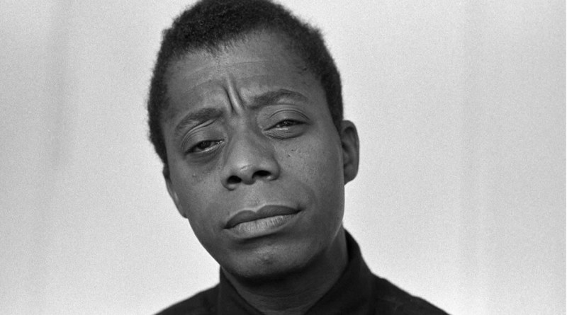 An image of author and activist, James Baldwin, squinting at the viewer.