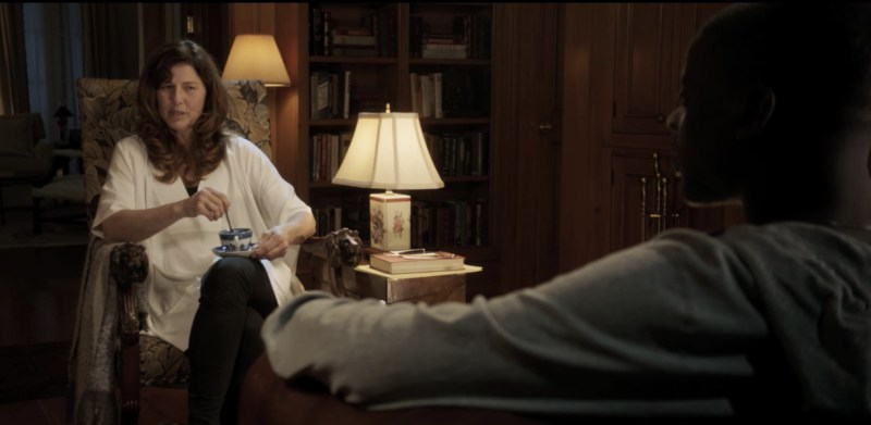An image showing Catherine Keener and Daniel Kaluuya sitting in a scene from the 2017 horror film Get Out.