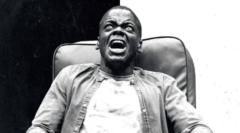 A black and white image of daniel kuluuya screaming in a chair, from the 2017 horror film Get Out.