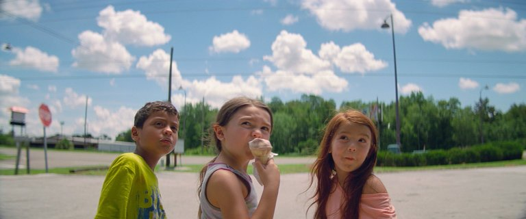 Three children on a sunny street in a still from The Florida Project