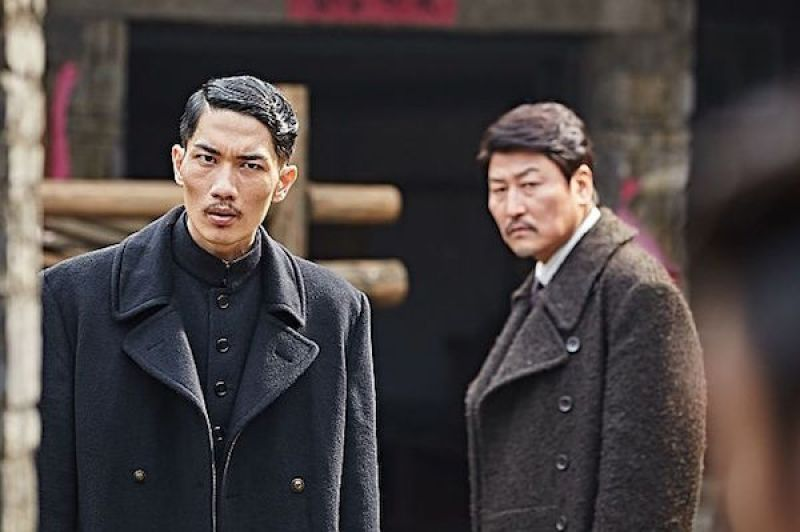 Left to Right: Hashimoto (Uhm Tae-goo) and Jung-chool (Song Kang-ho) in the 2016 Kim Jee-woon spy thriller, Age of Shadows.