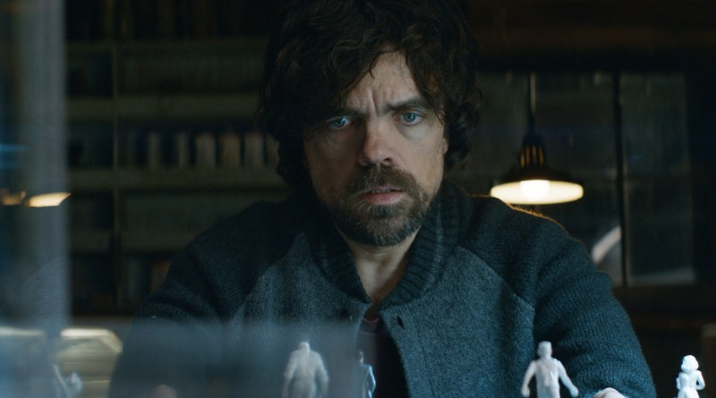 Pictured: Peter Dinklage overseeing a table of figurines in a scene from the 2017 sci-fi crime mystery film, Rememory.