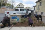 Planting the rain garden at AET.