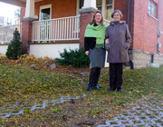 Catherine Fife and Elizabeth McLaughlin standing on their new driveway