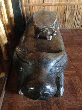 carved statue of a carabao ( i think)