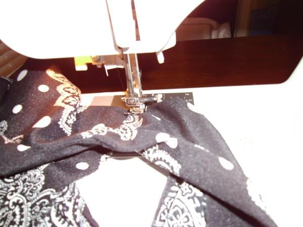 sewing shoulders of dress