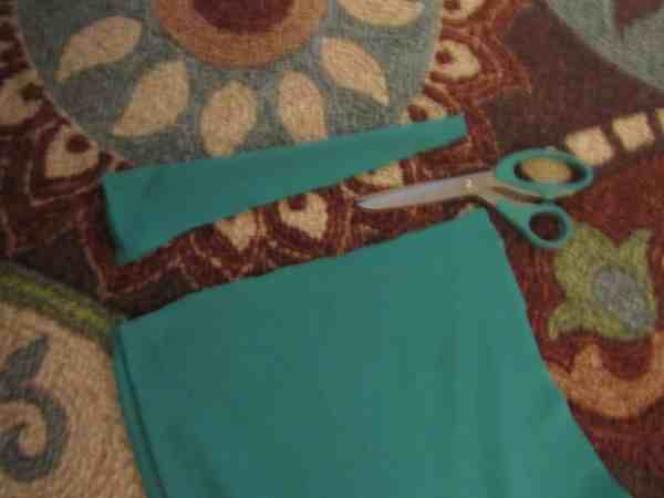 Snipping bottom scrap to make sash for thrift store dress