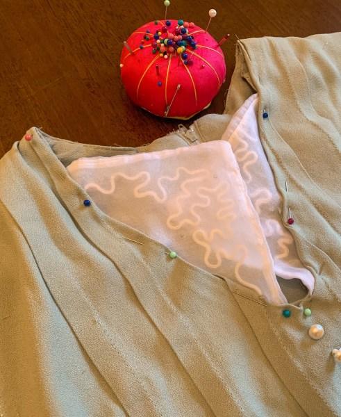 pinning repurposed collar on to dress