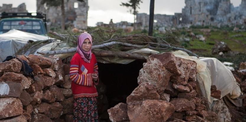 Une réfugiée dans un abris de fortune (Daniel Leal-Olivas-AFP)