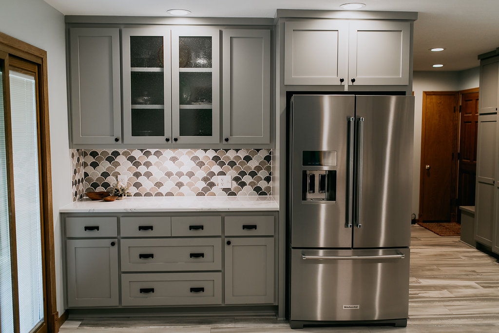 Grey cabinets, stainless steel fridge, contemporary kitchen