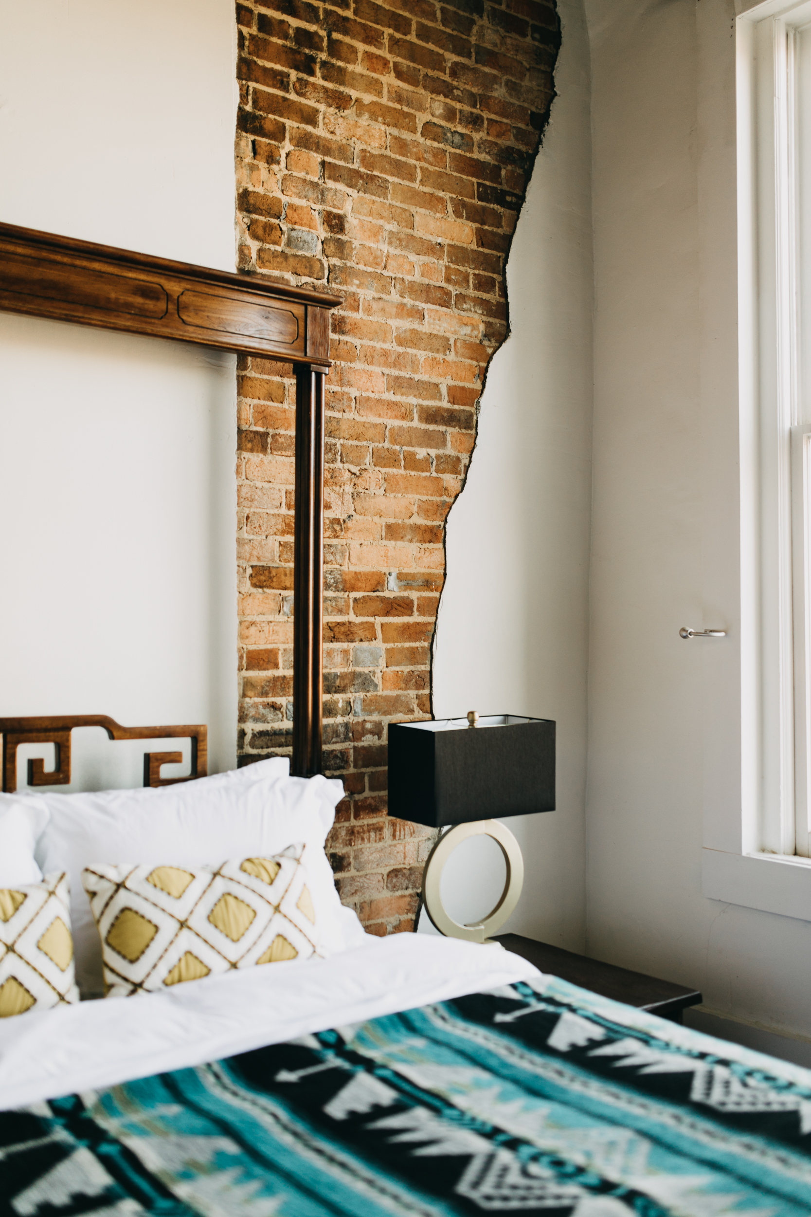 Springfield mo airbnb, Exposed brick wall in master suite