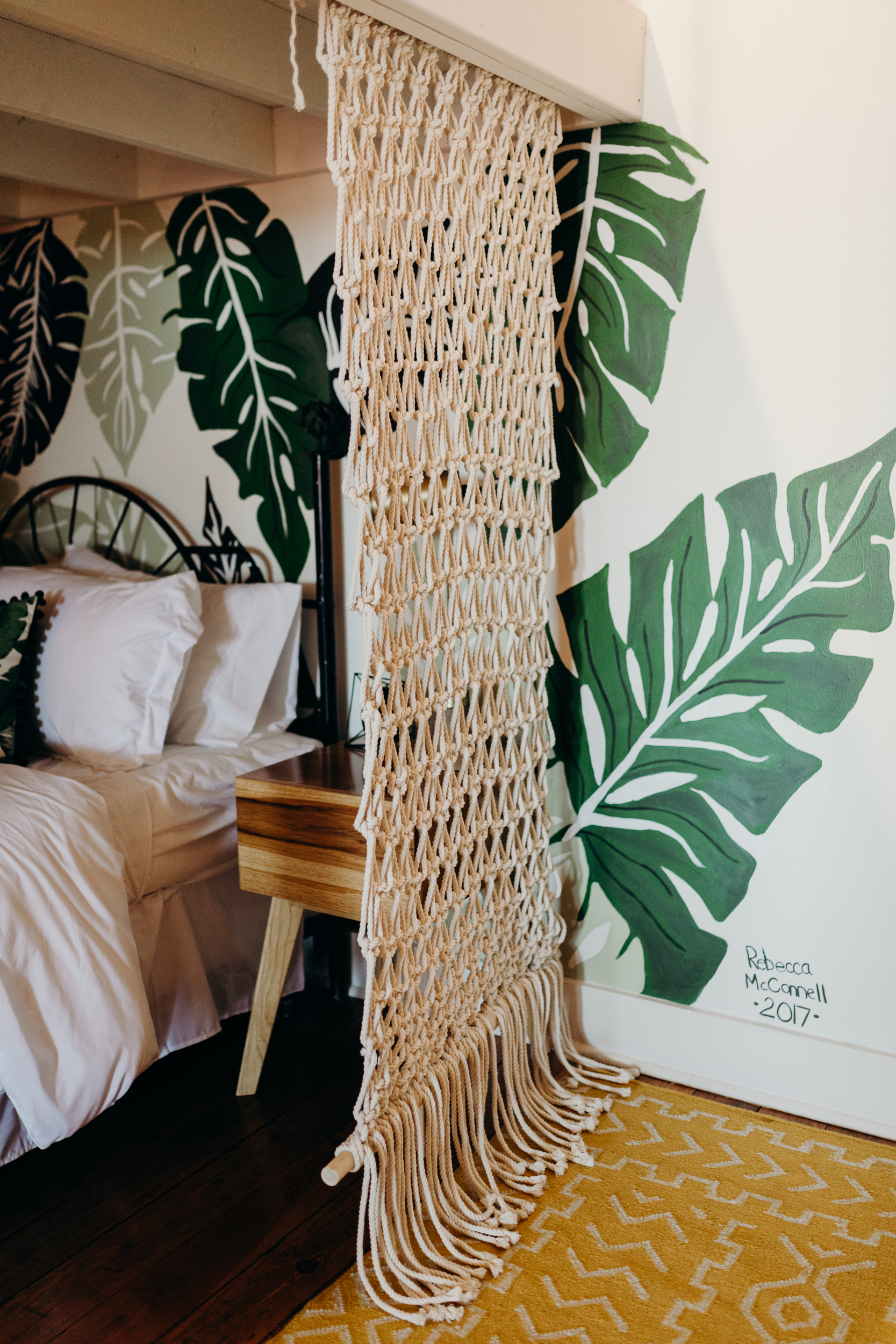 Woven hanging from loft in airbnb