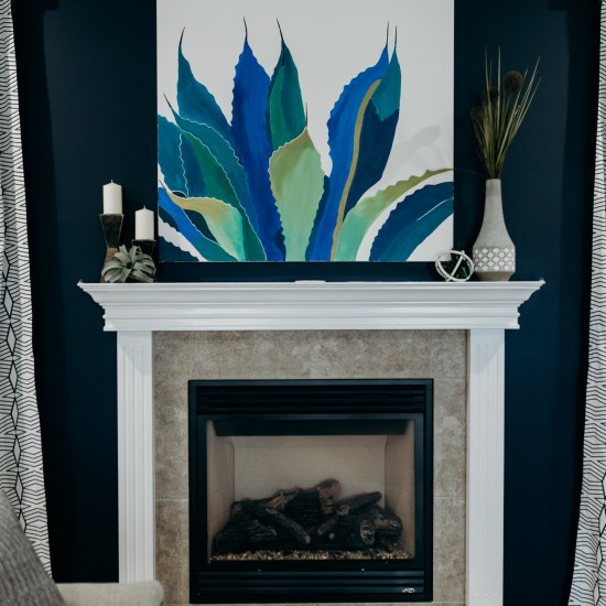 Fire place with blue, teal, and green painting, interior design