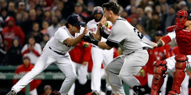 Apr 11, 2018; Boston, MA, USA; New York Yankees first baseman Tyler Austin (26) starts a scrum with Boston Red Sox relief pitcher Joe Kelly (56) during the seventh inning at Fenway Park. Mandatory Credit: Winslow Townson-USA TODAY Sports - 10781860