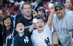 Yankees Fans - For The Love Of Baseball Photo Credit: Maxim.com