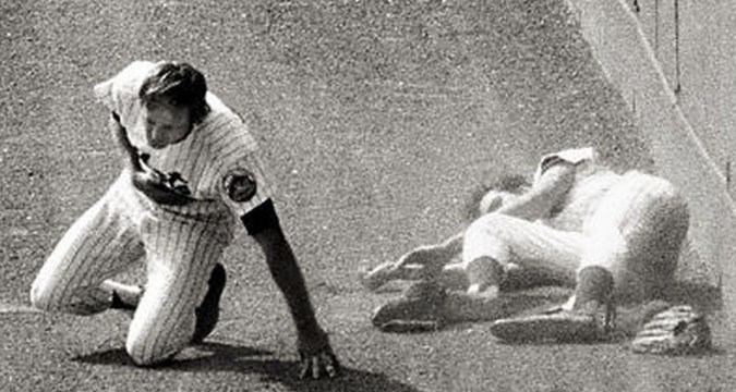 George Theodore dislocates his hip after colliding with Don Hahn in July 1973 game at Shea. (Dan Farrell/News)