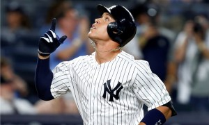 New York Yankees' Aaron Judge points skyward after hitting a fifth-inning solo home run against the Milwaukee Brewers in a baseball game in New York, Friday, July 7, 2017. (AP Photo/Kathy Willens) ORG XMIT: NYY114