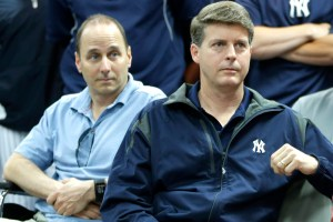 Brian Cashman, Hal Steinbrenner, (Photo Credit) (AP Photo/Kathy Willens)