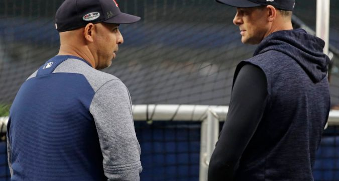 Aaron Boone and disgraced Alex Cora (AP Photo/Frank Franklin II)