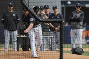 Yankees pitching coach Matt Blake watches closely (AP)