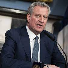 "Bill de Blasio says ""Let 'em in"""