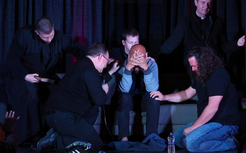chan being prayed over by catholic priests