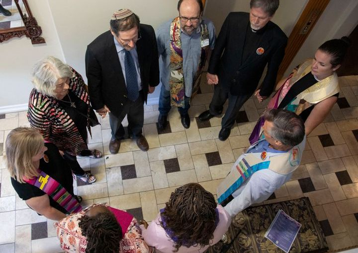 Clergy gather to pray at Whole Woman's Health of Austin on Tuesday, July 9, 2019.