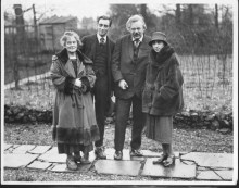 February 1926, Beaconsfield, Buckinghamshire, England, UK --- The writer G.K. Chesterton (r) with his wife (l) and another couple in the garden of their home in Beaconsfield, Buckinghamshire, 1926. --- Image by © Hulton-Deutsch Collection/CORBIS