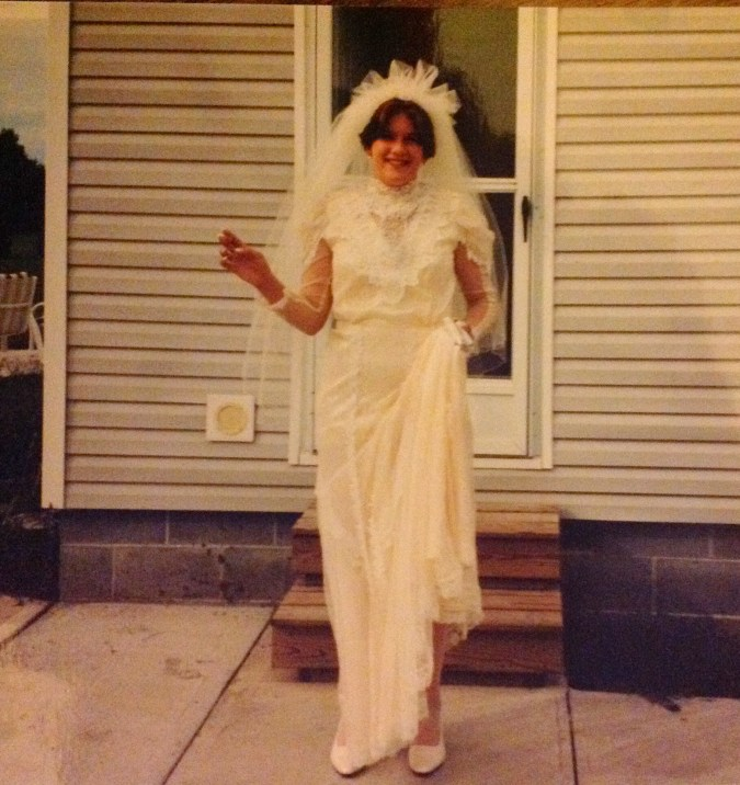 Me when my first husband and I renewed our vows (we had eloped a few months prior). Love it cuz yes, I'm smoking in the dress. LOL