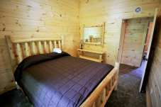Bedroom in Family Cabin Rentals