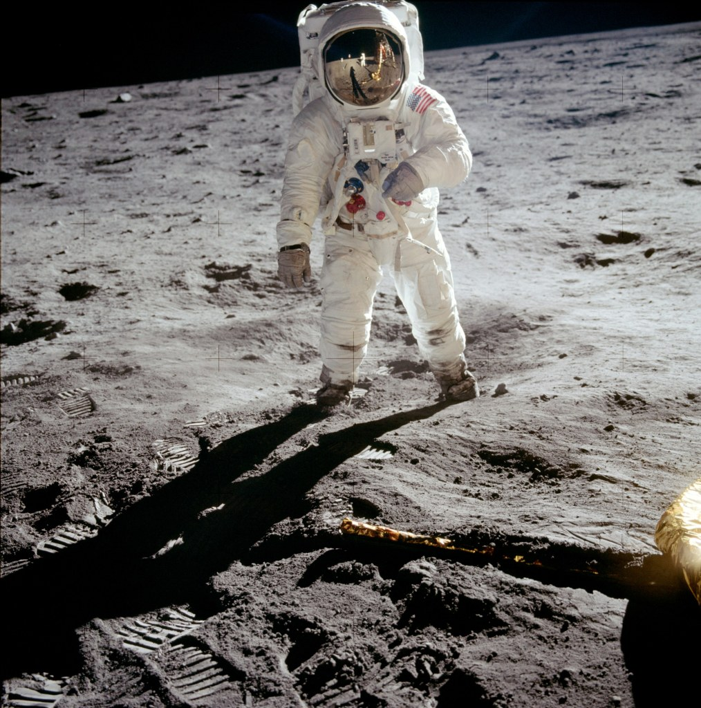 Astronaut Buzz Aldrin walks on the surface of the moon near the leg of the lunar module Eagle during the Apollo 11 extravehicular activity (EVA). Photo courtesy of NASA
