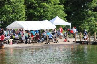 People enjoying breakfast on Refugee Island, Brockville, during Island Breakfast