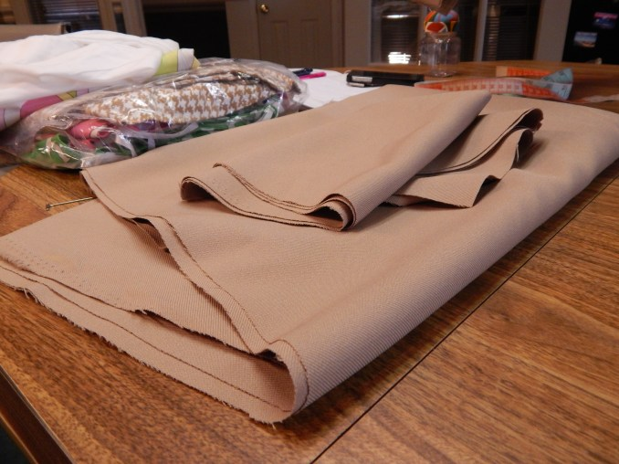 The bottom half, top half and sleeves rest neatly on Amy's work table.