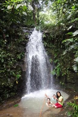 Volunteers enjoy a swimming hole