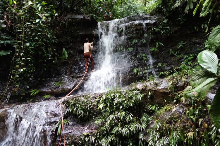 Volunteers go on the repelling waterfall hike