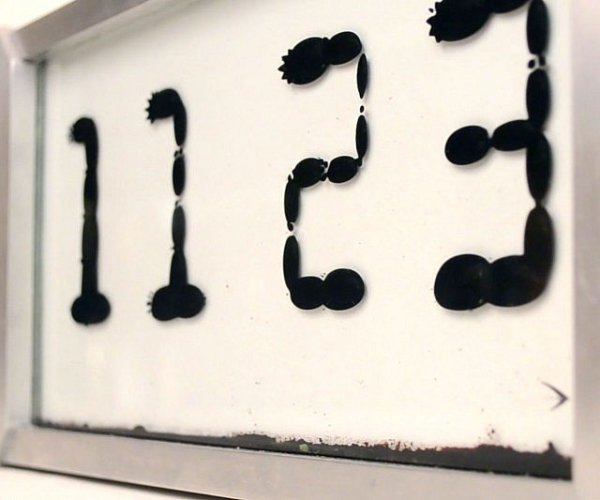 casa-ufficio Orologio ferrofluido