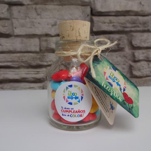 Botella con corcho y dulces