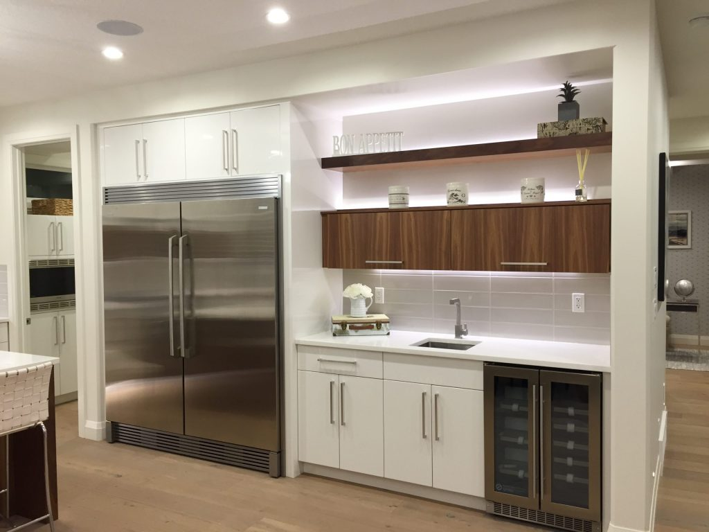 Two-tone white and walnut kitchen.