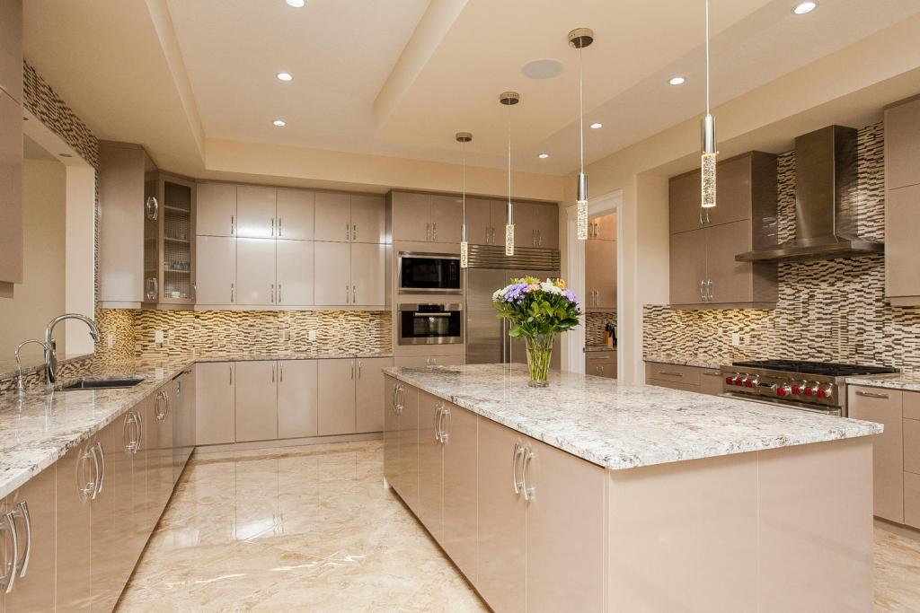 Beautiful beige high gloss kitchen.