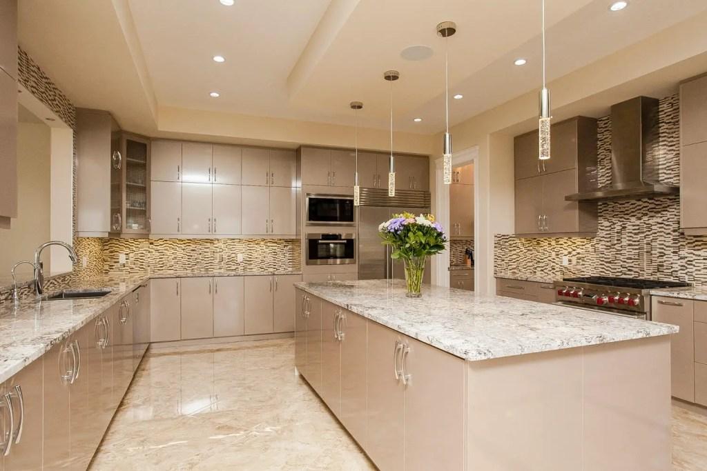 Beautiful beige high gloss kitchen.