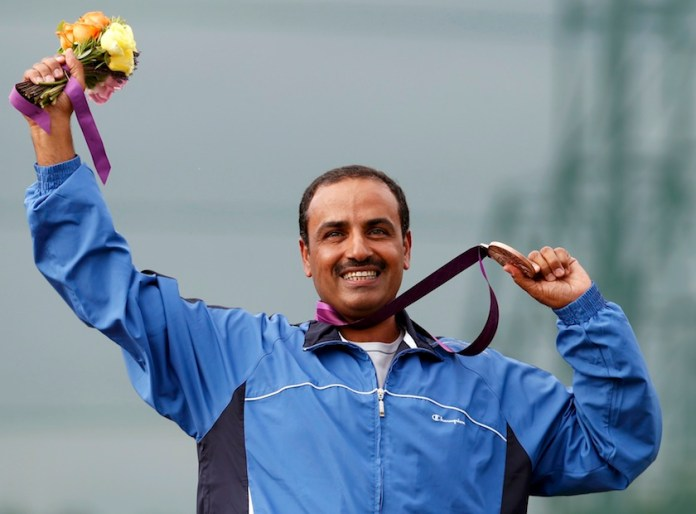 Bronze medallist Kuwait's Fehaid Aldeehani poses at the men's trap shooting victory ceremony at the London 2012 Olympic Games at the Royal Artillery Barracks August 6, 2012.      REUTERS/Suzanne Plunkett (BRITAIN  - Tags: SPORT OLYMPICS SPORT SHOOTING)