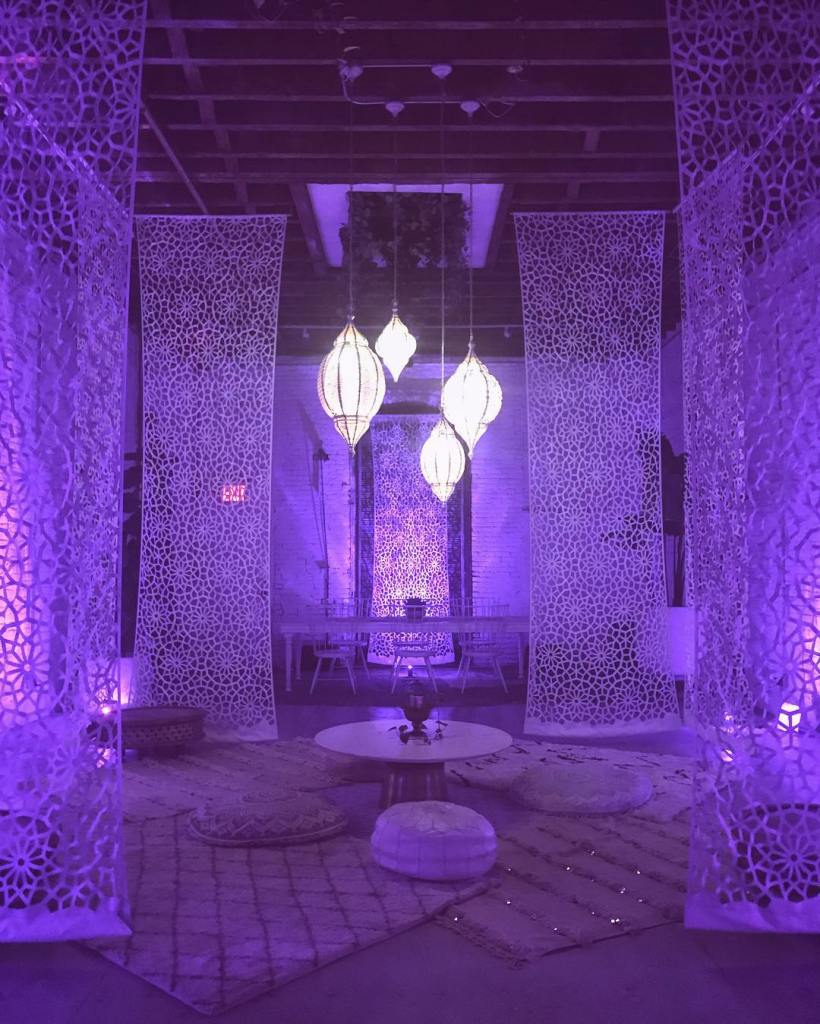 White curtains lit by purple lighting at Regency Event Center in Brooklyn, New York