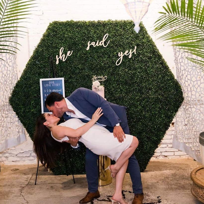 "Man dips women in front of sign that reads ""She said yes!"" at Regency Event Venue"