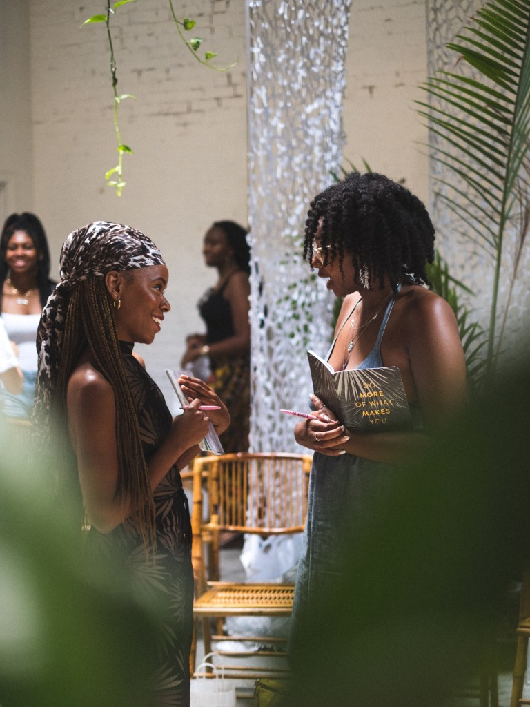 Two women talk at the White Room of Regency Community and Event Venue