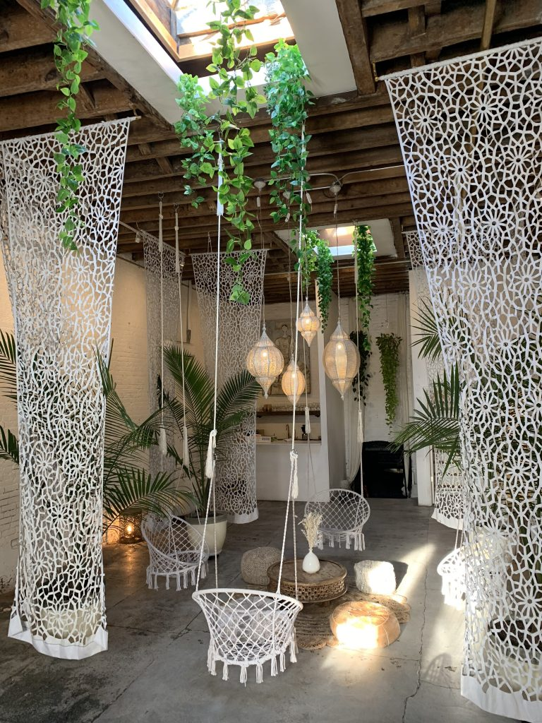 Bespoke White Curtains, hanging plants, skylight at Regency Event Venue's White Room